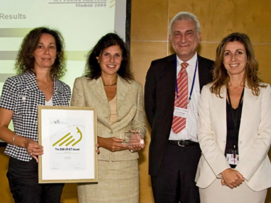 Rosa Lopez (IFEMA), Maria Martinez Garcia (IFEMA), and Marcela Lupi (IFEMA) received the UFI ICT award from UFI ICT Committee Chair Werner Krabec.